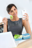 Businesswoman having lunch — Stock Photo