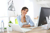Office worker sitting at desk — Stock Photo