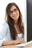 Business girl with eyeglasses — Stock Photo