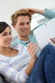 Couple websurfing with tablet — Foto Stock