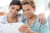 Couple websurfing with tablet — Stock Photo
