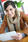 Woman websurfing with tablet — Stock Photo