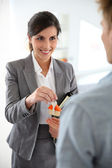 Smiling real-estate agent — Stock Photo