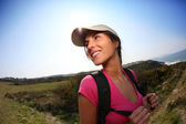 Brunette girl on a hiking day — Stock Photo