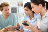 Young people using smartphones — Stock Photo