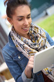 Student girl using tablet — Stock Photo