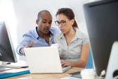 Man and woman working together — Stock Photo