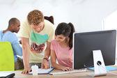 Students working on desktop — Stock Photo