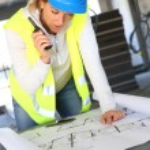 Woman engineer with radio set — Stock Photo #47779383