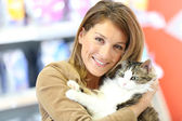 Smiling woman with cat — Stock Photo