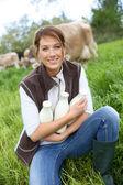 Woman holding bottles of milk — Stock Photo
