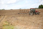 Tractor in agricultural field — Stock Photo