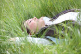 Woman on grass in field — Stock Photo