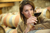Woman looking on wine — Stock Photo