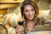 Mature woman tasting wine — Stock Photo