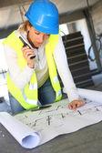 Woman engineer with radio set — Stockfoto