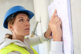 Architect reading construction plan — Stock Photo