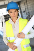 Woman architect standing in building — Stock Photo