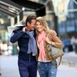 Embracing couple doing shopping — Stock Photo #47780435