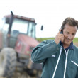 Farmer with phone in field — Stock Photo #47786955
