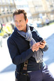 Man using smartphone — Stock Photo