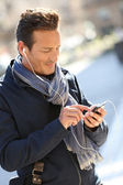 Man in town talking on the phone — Stock Photo