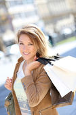 Woman with shopping bags on shoulder — Stock Photo