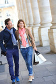 Embracing couple with shopping bags — Stock Photo