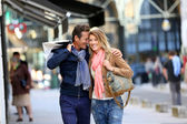 Embracing couple doing shopping — Stock Photo