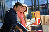 Couple by book fair on week-end — Stock Photo