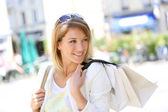 Woman shopping in town — Stock Photo