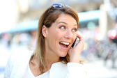 Mature woman laughing on the phone — Stock Photo
