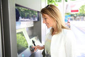 Woman withdrawing money — Stock Photo