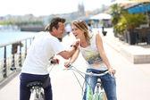 Couple riding bikes — Foto de Stock