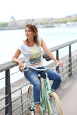 Woman with bicycle on promenade — Stock Photo