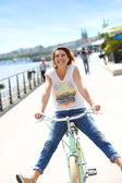 Woman on bicycle on Bordeaux Docks — Stock Photo