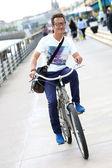 Smiling man on bicycle — Foto Stock