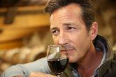 Winemaker tasting wine in cellar — Stock Photo