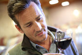 Winemaker tasting red wine — Stock Photo