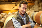 Winemaker in wine cellar — Stock Photo