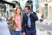 Couple with bags on shoulder — Stock Photo