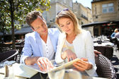Couple at terrasse in restaurant — Stock Photo