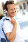 Trendy man talking with handsfree — Stock Photo