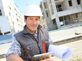 Builder on building site — Stock Photo