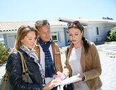 Couple meeting real-estate agent — Stock Photo