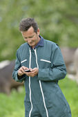 Farmer sending message — Stock Photo