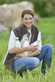 Breeder woman holding bottles — Stock Photo