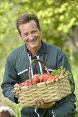 Farmer holding basket — Stock Photo