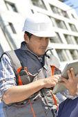 Entrepreneur on building site — Stock Photo