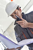 Worker checking blueprint — Stock Photo